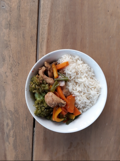A bowl of basmati rice and stir fry vegetables